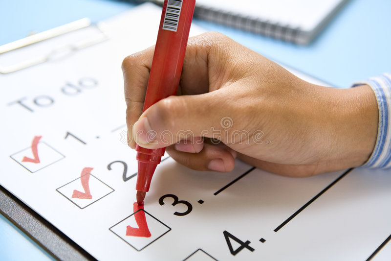 Hand check mark the list stock images
