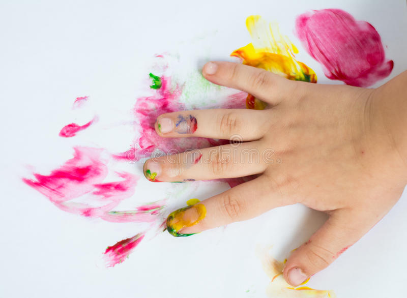 Hand of child while doing fingerpaint stock photo
