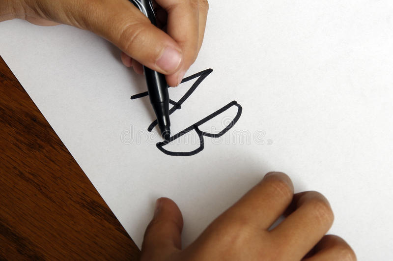 Hand child writing AB. Close up of left Hand child writing AB on white paper royalty free stock images