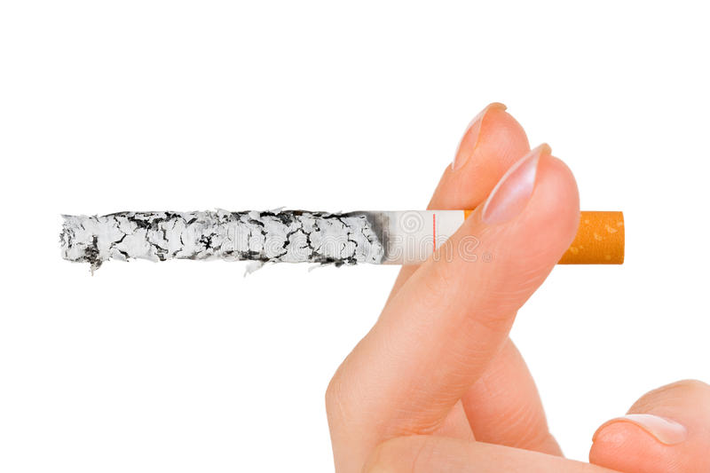 Hand with cigarette. Isolated on white background stock photo