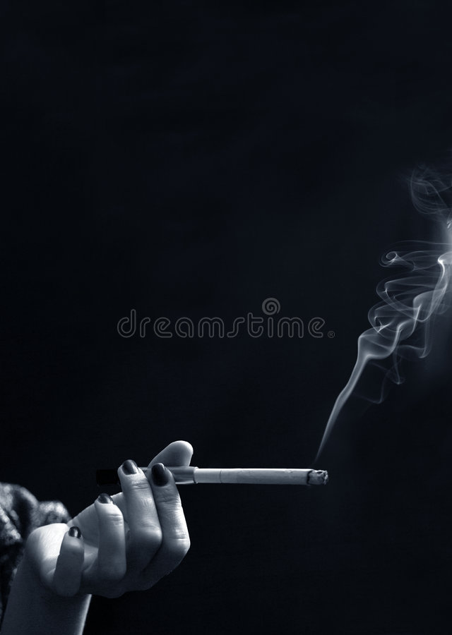 Hand with a cigarette royalty free stock photo