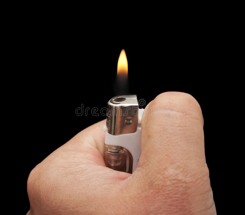 Hand with a cigarette lighter royalty free stock image