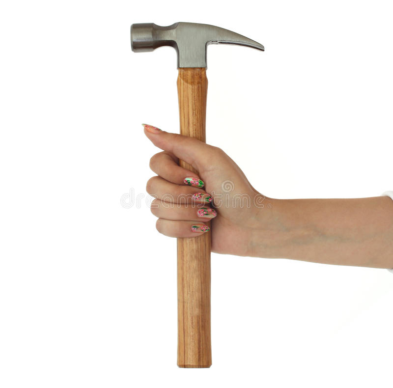 Hand with claw hammer. Hammer in a beautiful female hand isolated on white background stock image