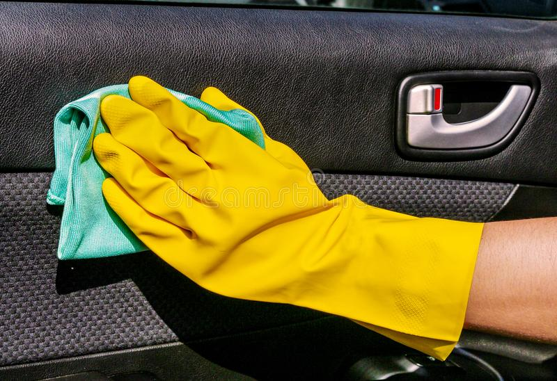 Hand Cleaning Interior Car Door Panel With The Microfiber Cloth . Worker At  The Car Wash