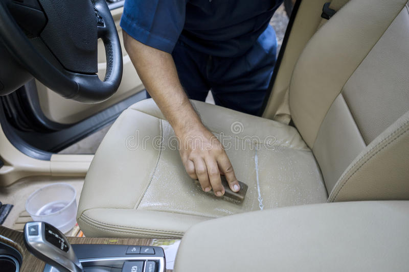 Hand Cleaning The Leather Car Seat Stock Photo - Image: 69671332