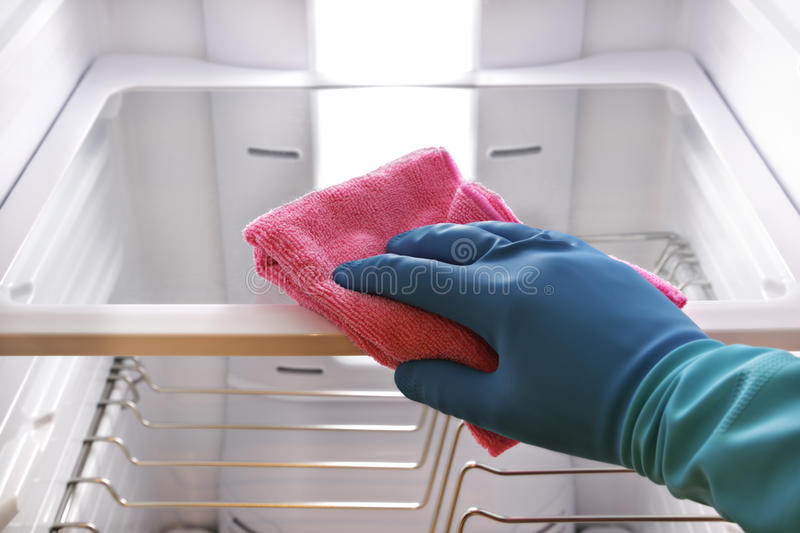 Hand cleaning refrigerator royalty free stock image
