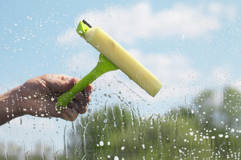 Hand cleaning window. royalty free stock photos
