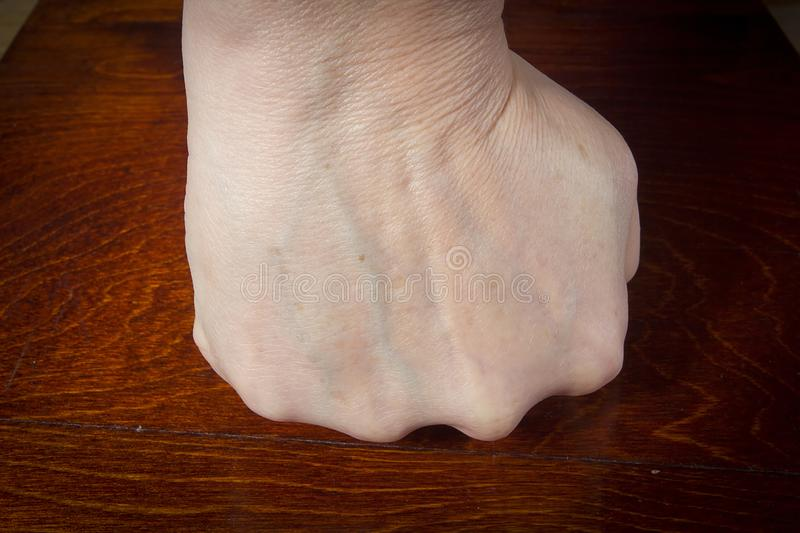 Hand clenched into a fist royalty free stock image