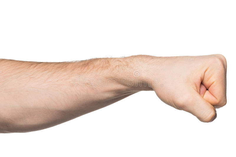 Hand with clenched a fist. Isolated on a white background royalty free stock image