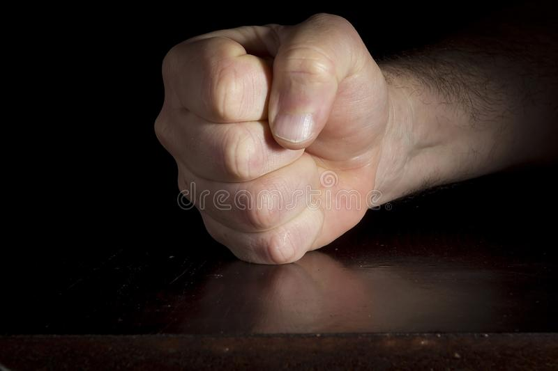 Hand clenched into a fist stock photo
