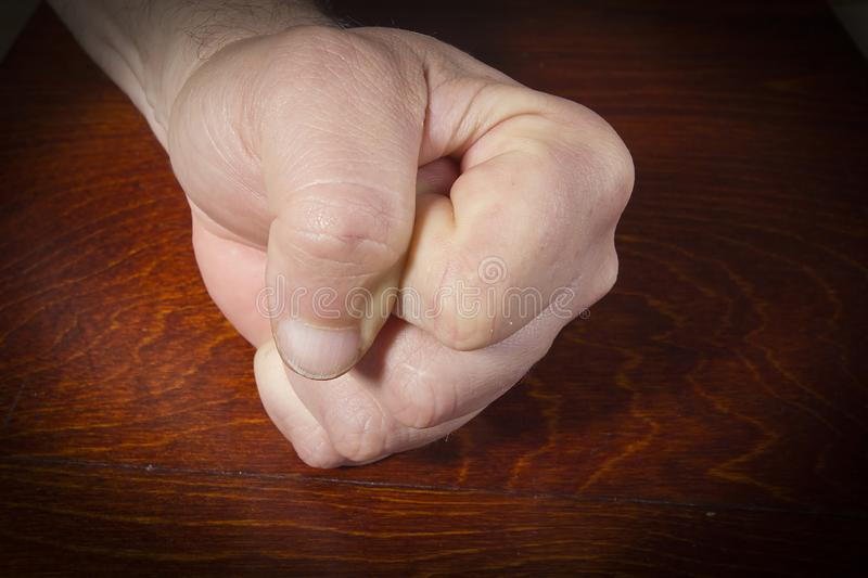 Hand clenched into a fist stock photos