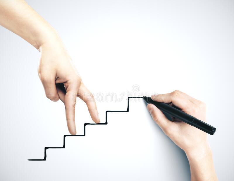Hand climbing on drawing stairs stock photos
