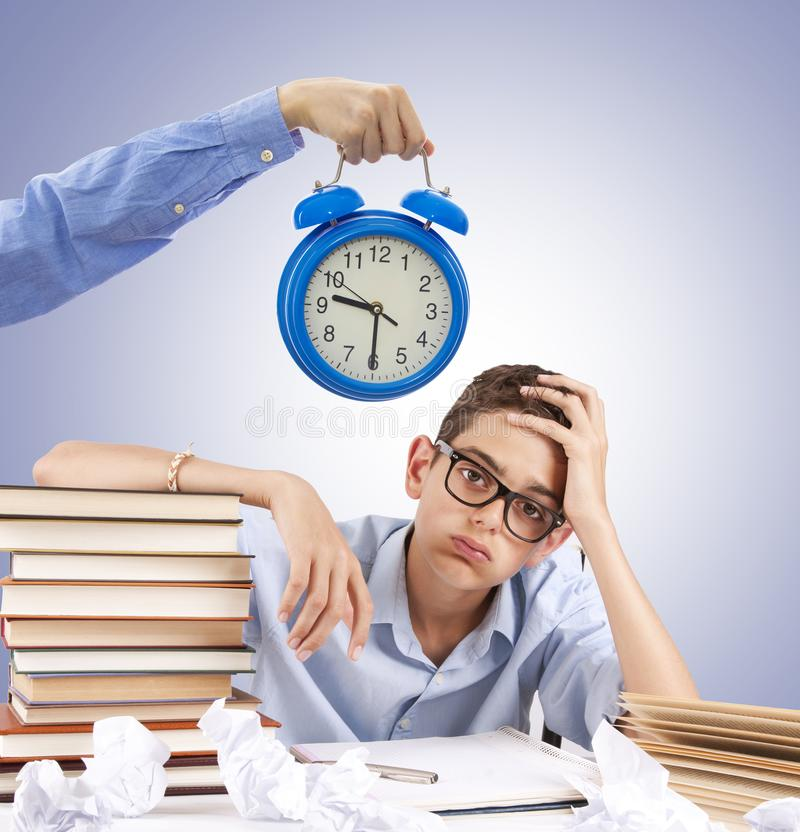 Hand-clocked and student at the desk. Stressful student and tired with the schedule stock photo
