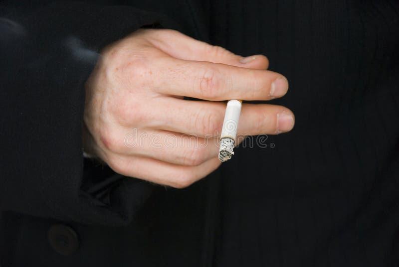 Hand closeup with cigarette stock photo