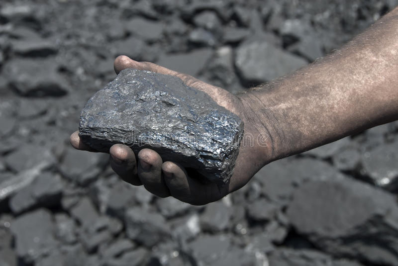 The hand with coal royalty free stock image