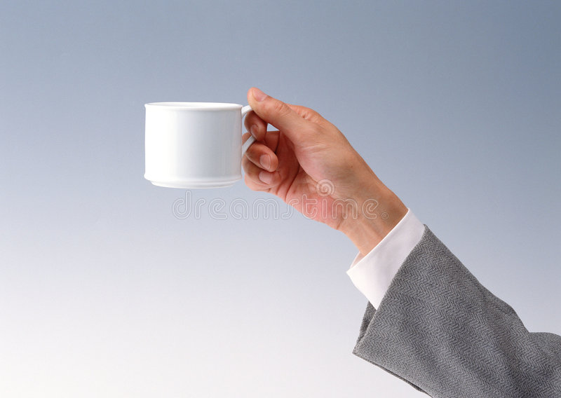 Hand with coffe cup royalty free stock image