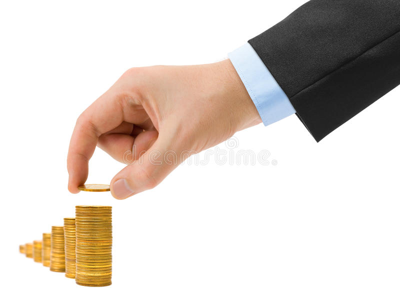 Hand with coin and money stairs stock photos