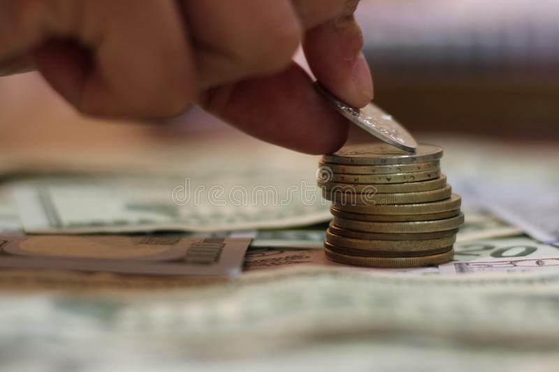 Hand with coins stock images
