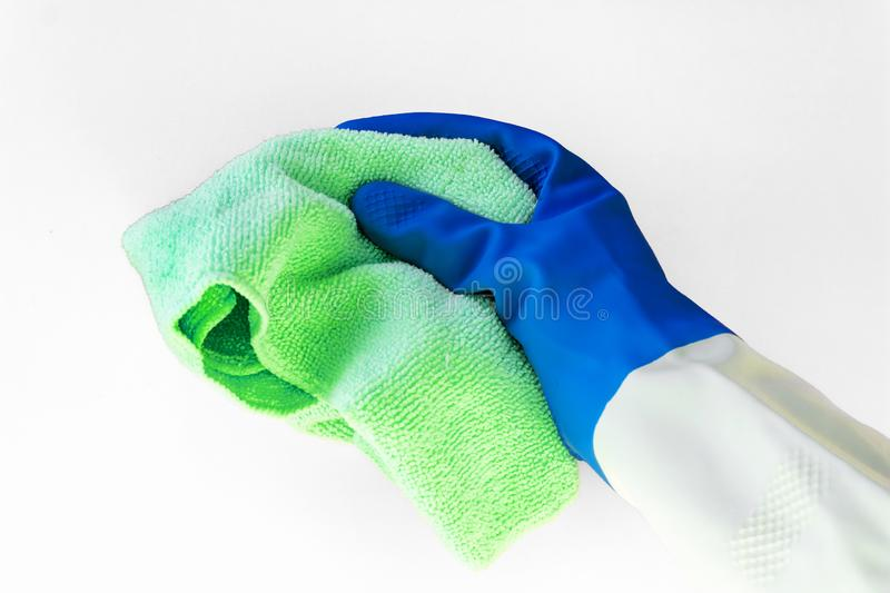 Hand in color rubber protective glove holds a bright microfiber duster isolated on the white background. accssesouries for. Different surfaces in room, bathroom royalty free stock photos