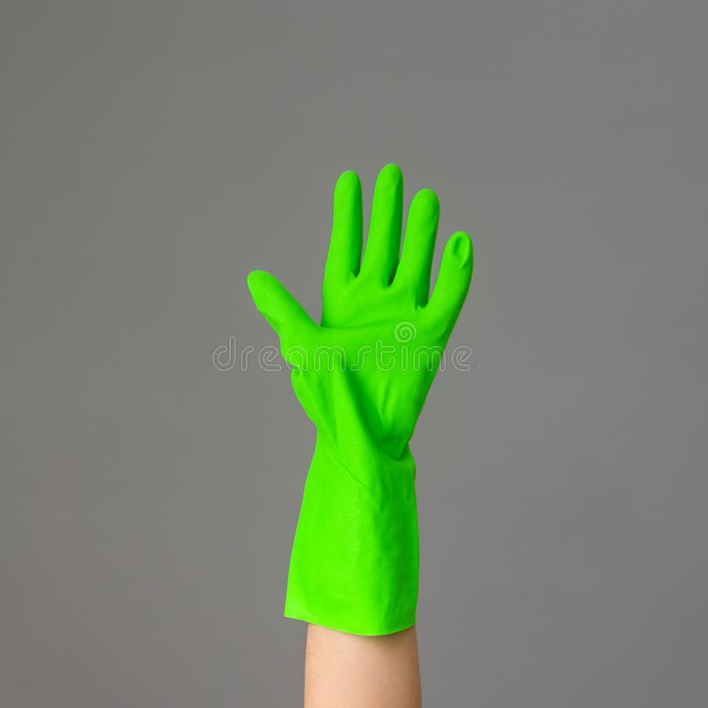 A hand in colorful protective rubber glove. Spring cleaning concept.. stock photography