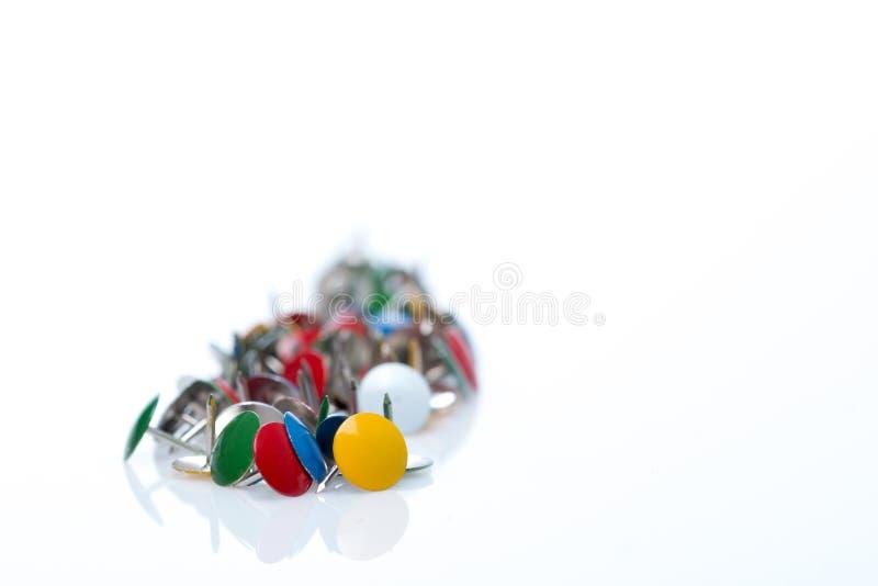 Hand of colorful tacks royalty free stock photos