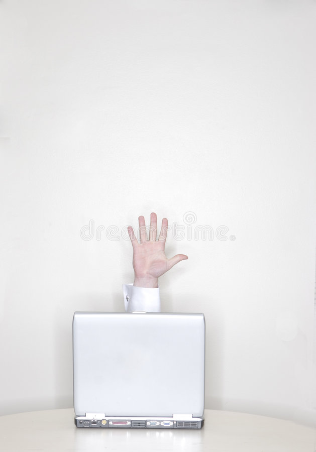 Hand coming out of laptop stock photography