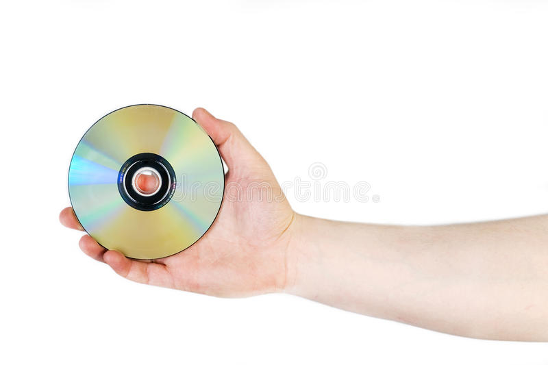 Hand with compact disc. Hand holding compact disc isolated on white royalty free stock photos