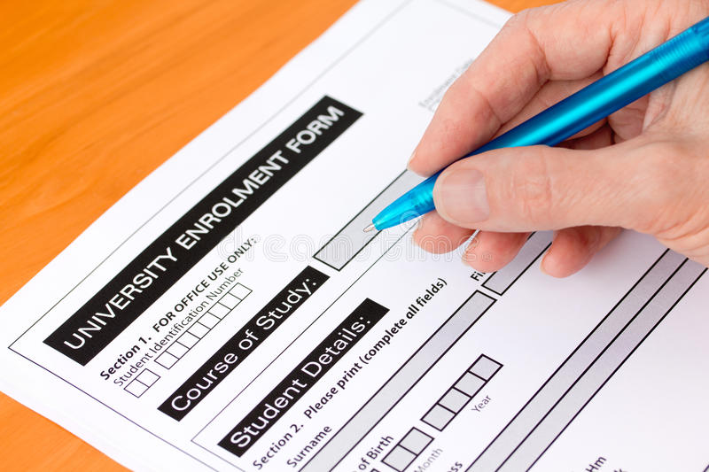 Hand Completing A University Application Form Stock Photos