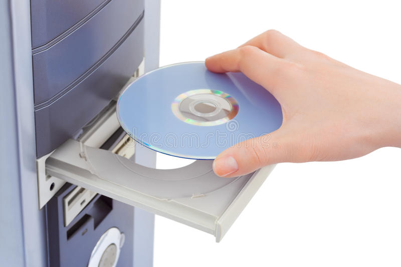 Hand and computer cd-rom. Isolated on white background royalty free stock image