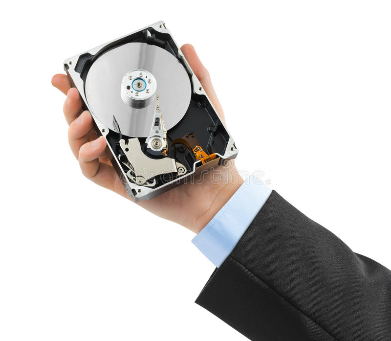 Hand and computer hard drive royalty free stock photography