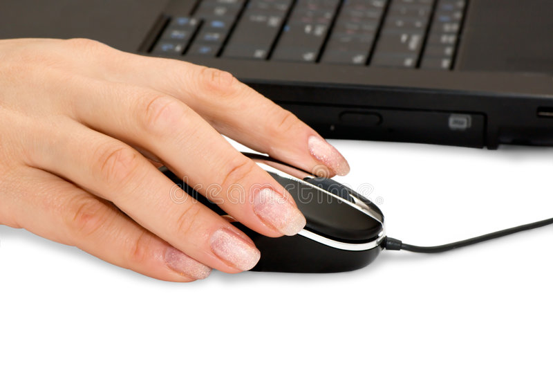 Hand & computer mouse. The hand and computer mouse stock images