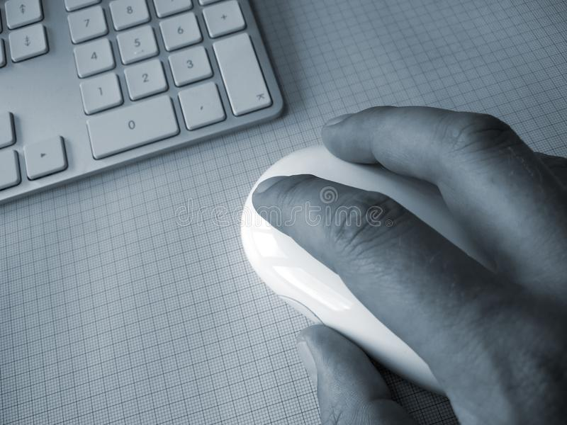 Hand on computer mouse stock image
