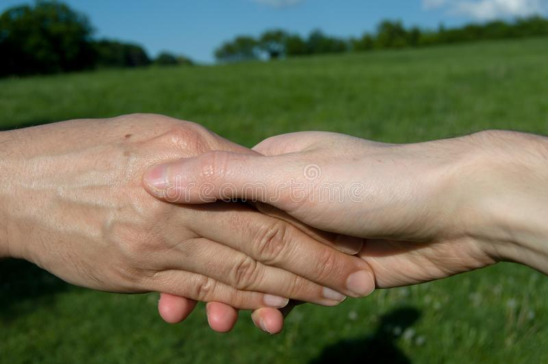 Hand contact. Symbol of partnership. stock images