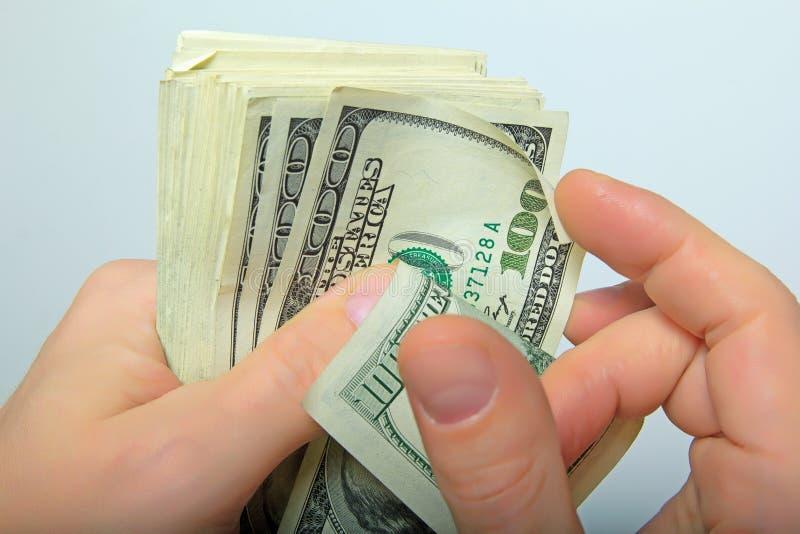 In hand contant geldamerikaanse dollars stock foto