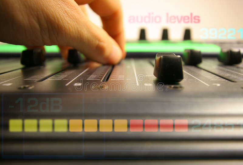 Hand controlling faders royalty free stock images