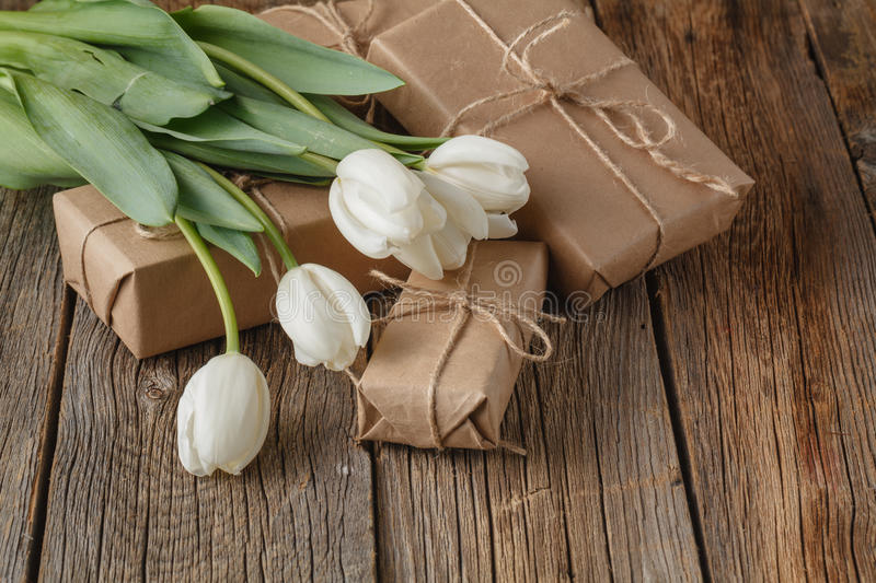 Hand crafted box present with tulips flowers stock image