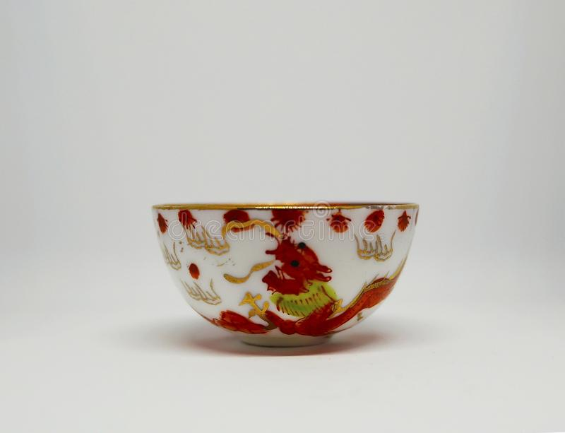 Hand-crafted Chinese cup. Isolated on white background stock photo