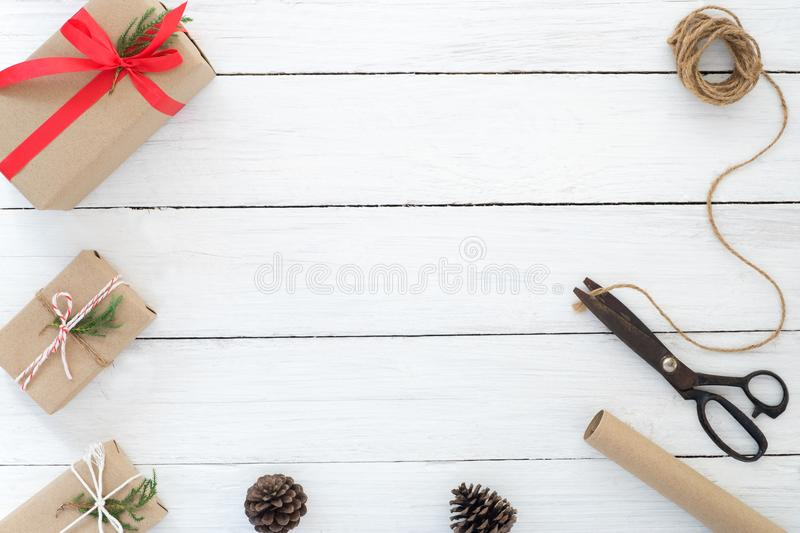 Hand crafted Christmas present gifts box and tools on white wooden background. royalty free stock photos