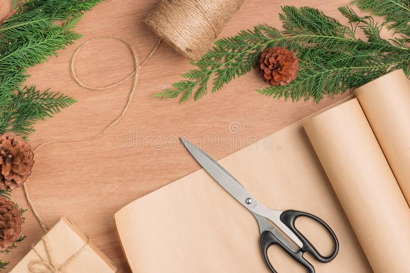 Hand crafted Christmas present gifts box and tools on wooden background stock images