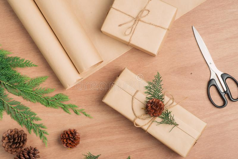Hand crafted Christmas present gifts box and tools on wooden background royalty free stock photos