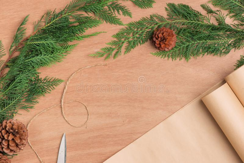 Hand crafted Christmas present gifts box and tools on wooden background royalty free stock photo