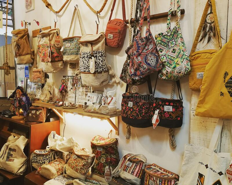Hand crafted cloth bags are hanging on streets of Bangkok Thailand stock images
