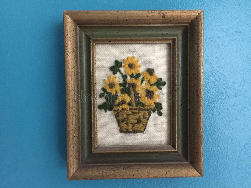 Hand crafted crewel picture of a basket of Sunflowers royalty free stock photos