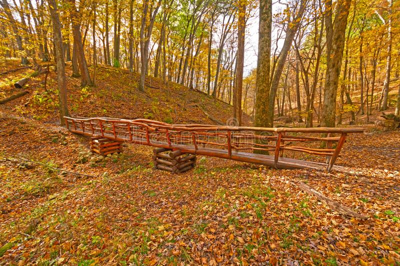Hand Crafted Foot Bridge in the Fall Forest stock photo