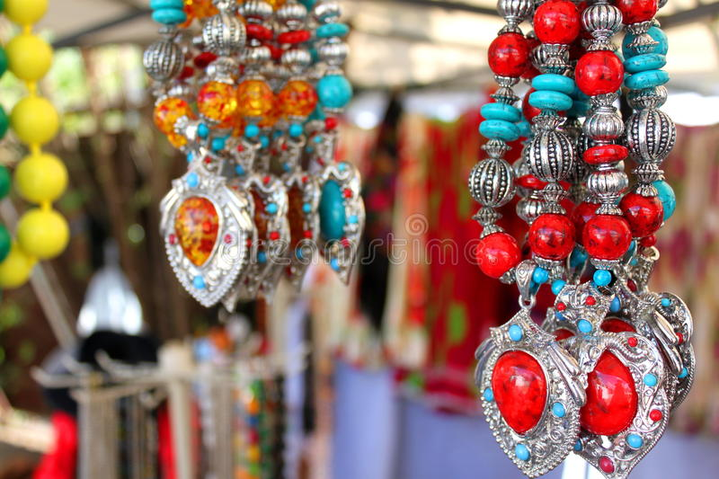 Hand crafted jewelry. Hand crafted colorful jewelry hanging stock photos