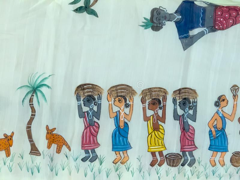 Hand crafted painting by tibals of India. Hand created painting by tribals of India depicting their daily life, women are taking pile of crop in the farm along stock photography
