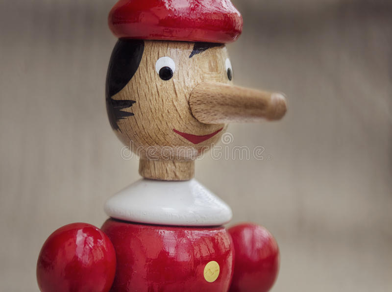 Hand crafted Pinocchio puppet character royalty free stock photo