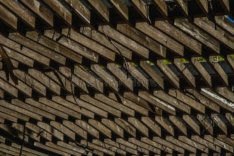 A Wooden Ceiling Canopy. A hand crafted wooden ceiling canopy in a garden environment stock photos