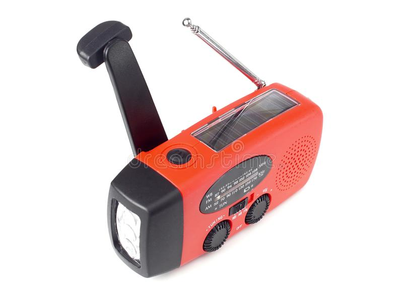 Hand crank weather radio. Emergency radio with flashlight rechargeable using built-in hand crank or solar cell stock image