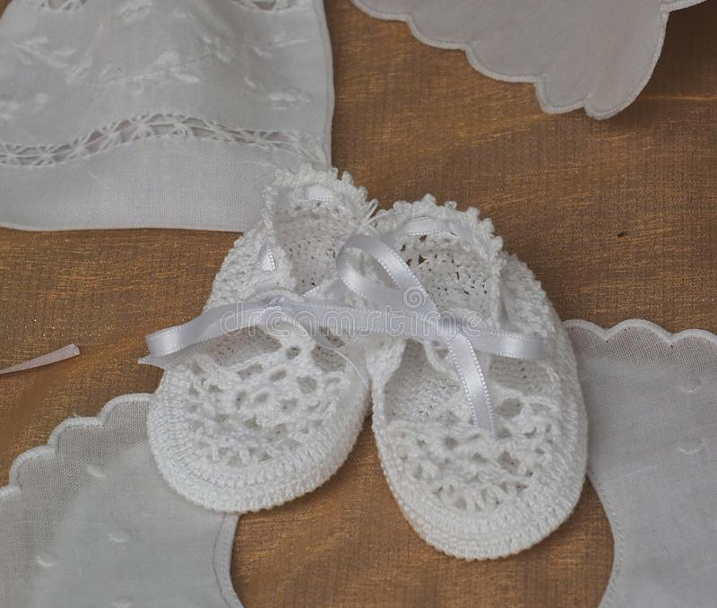 Hand Crocheted Baby Shoes AtMarket In Loule Portugal. Delicate hand crocheted baby shoes for sale at the market in Loule Portugal royalty free stock photos